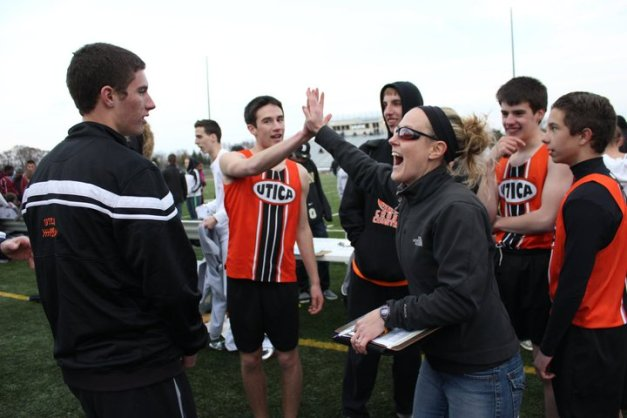 Celebrate success! I high-five a few of my track athletes after a successful race.